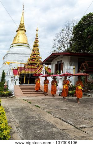 Lampang Province Thailand. 5 July 2016 : Many monks of Thailand assembled religious rituals homage to the Buddha in the Day before the Buddhist Lent at the Wat Phra That Lampang Laow at Wat Phra Kaew Don Tao is a Lanna-style Buddhist temple in Lampang Tha