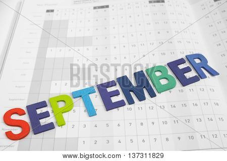 September - monthly on date number calendar paper - colorful uppercase letter September month