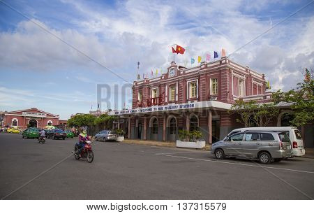 Hue, Vietnam - Jun 18, 2016: Front view of Hue Railway Station. Traveling by old and noisy train crossing Vietnam is one of the most favorite way of visiting a developing country for foreign tourist.