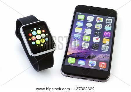 GALATI ROMANIA - FEBRUARY 17 2016: Apple Watch Sport 42mm Silver Aluminum Case with Black Sport Band displaying the apps screen next to the iPhone 6s displaying the home screen. The Apple Watch is the latest device