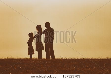 Parents had a conflict with their daughter and now they are consoling her but she is very angry.