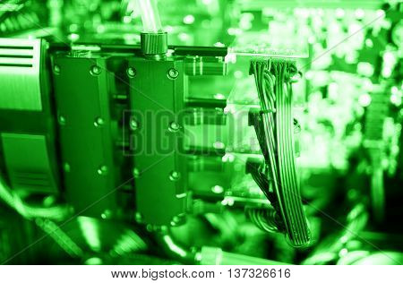 Horizontal green gpu quad sli video card bokeh background