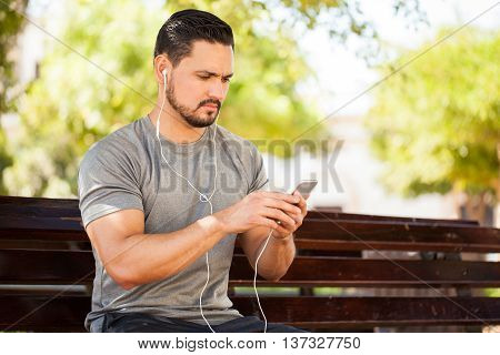 Man Listening To Music At The Park