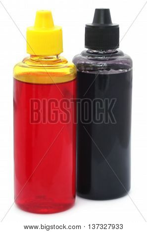 Two printer ink bottles over white background