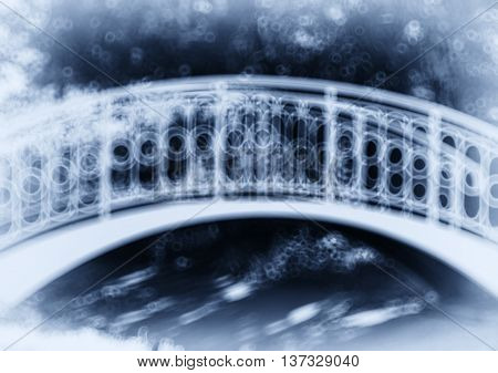 Horizontal blue park arc bridge bokeh vignette abstraction background