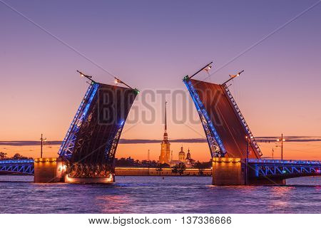 Opening of Palace drawbridge White nights in Saint Petersburg view of Peter and Paul Cathedral through the bridge