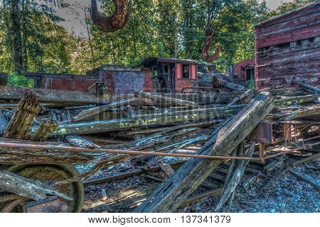 A view of wreckage in a derelict train yard. HDR image.
