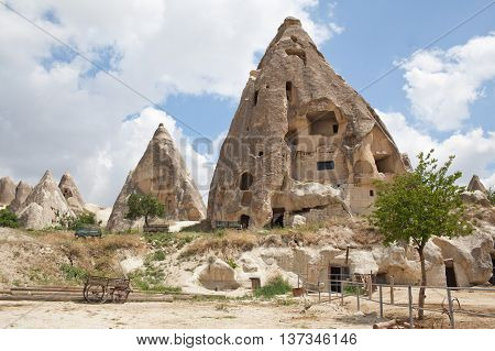 Rugged rock formations riddled with ancient cave houses near Goreme Cappadocia Turkey. Close up
