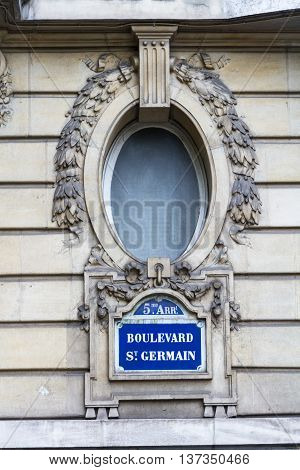 Sign for Boulevard Snt Germain. Road sign on wall Paris France.