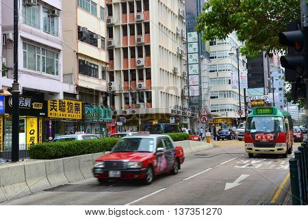 HONG KONG - NOV 10: Taxi and mini bus on Austin Road near Nathan Road on Nov 10, 2015 in Kowloon, Hong Kong.