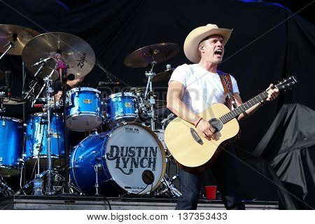 NASHVILLE-JUL 11: Country recording artist Dustin Lynch performs during the 'Kick The Dust Up' Tour at Vanderbilt Stadium on July 11, 2015 in Nashville, Tennessee.