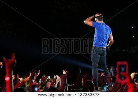 NASHVILLE-JUL 11: Country recording artist Luke Bryan performs during his 'Kick The Dust Up' Tour at Vanderbilt Stadium on July 11, 2015 in Nashville, Tennessee.
