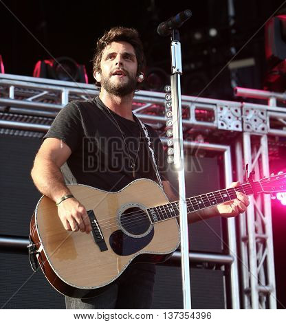NASHVILLE-JUL 11: Country recording artist Thomas Rhett performs during Luke Bryan's 'Kick The Dust Up' Tour at Vanderbilt Stadium on July 11, 2015 in Nashville, Tennessee.