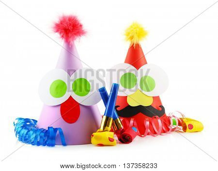 Funny party hats with blowers on a white background