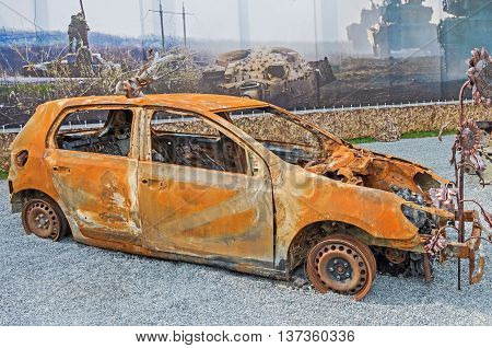 Dnepropetrovsk Ukraine - May 19 2016: Open air museum dedicated to war in the Donbass. Burned car as a result of war in the Donbass