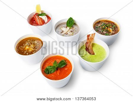 Variety of restaurant hot dishes from different cuisines, healthy food. Japanese miso soup, asian fish soup, russian borscht, english pea soup, mushroom soup, spanish gazpacho isolated at white.