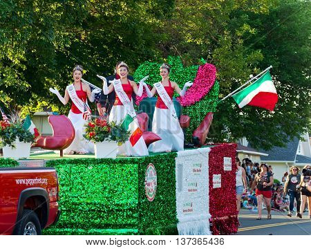 SOUTH ST. PAUL, MINNESOTA - JUNE 24, 2016: North Hudson Wisconsin Pepper Fest Royalty entertains crowd from atop float at annual Kaposia Days Grande Parade in South St. Paul Minnesota on June 24.