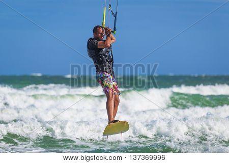 Athletic Man Riding On Kite Surf Board Sea Waves