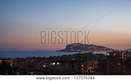 Late evening view of Alanya peninsula from Tosmur district. Alanya, Antalya province, Turkey.