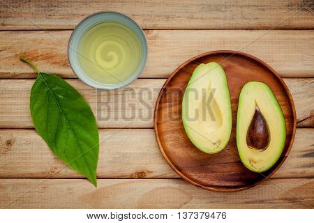 Fresh Avocado On Wooden Background. Organic Avocado Healthy Food Concept.
