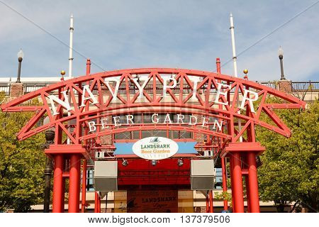 CHICAGO, ILLINOIS - AUGUST 22, 2015: Navy Pier Beer Garden Sign. Navy Pier is a 3,300-foot-long pier on the Chicago shoreline of Lake Michigan.