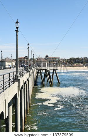 HUNTINGTON BEACH, CA - MARCH 25, 2015: Huntington Beach pier. The pier was built in 1904 and rebuilt after storms in the 1980's.
