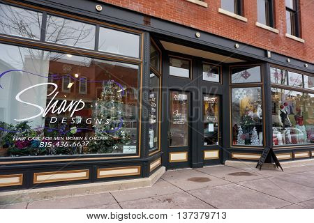 PLAINFIELD, ILLINOIS / UNITED STATES - DECEMBER 29, 2015: One may have one's hair cut at Sharp Designs inside the historic Opera House Block Building in downtown Plainfield.