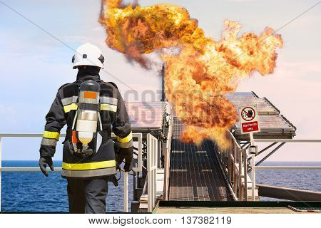 Fire fighter on oil and gas industry, successful firefighter at work , Fire suit for fighter with fire and suit for protect fire fighter, Security team when fire case. restricted area or danger area.