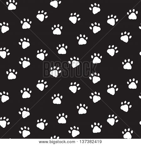 Seamless pattern with black and white cat paws footprints. Vector illustration