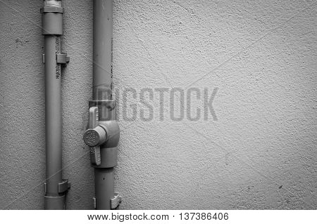 PVC pipe water pipe piping of wall surrounding a house.