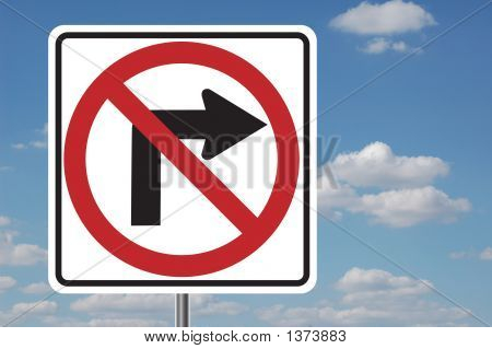 No Right Turn Sign With Clouds
