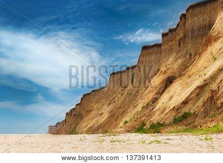 Empty wild Black Sea beach under the coast precipice in Odessa region Ukraine