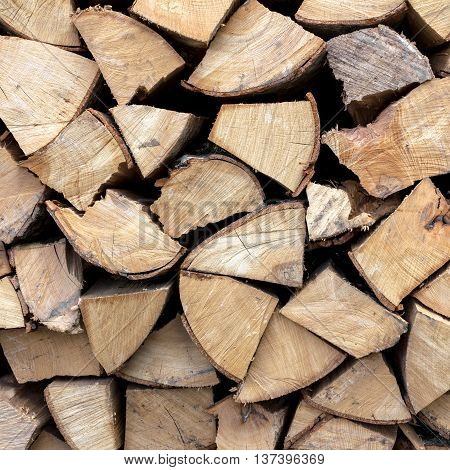 Firewood neatly stacked in the woodpile. Stock for winter.