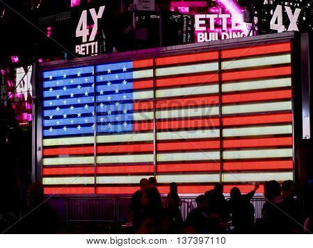 NEW YORK CITY - APRIL 21: Times Square, big USA LED Flag,April 21, 2016 in Manhattan in the evening, New York City. USA.