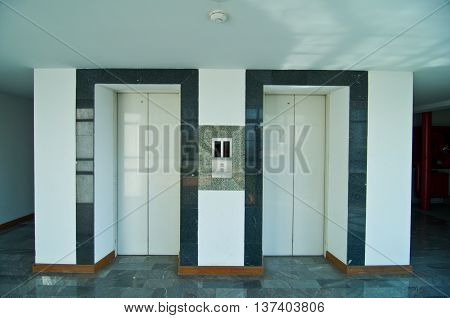 Elevator with two silver door in hotel