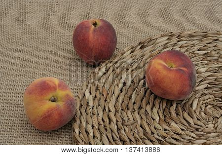 three peaches on the mat and on canvas