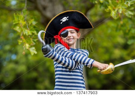 Boy pretending to be a pirate in the park