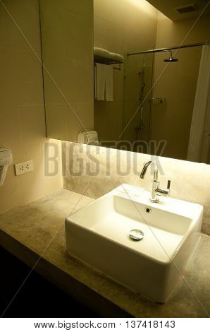 white sink with chrome faucet in home