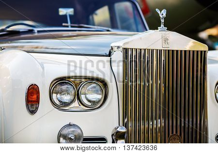 MINSK BELARUS - MAY 07 2016: Close-up photo of Rolls Royce. Close-up of the front part of the luxury retro car. Selective focus on the headlight.
