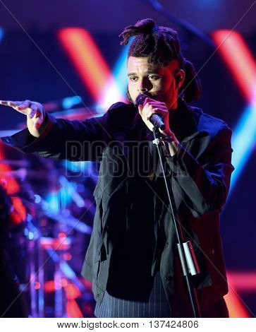 HOLLYWOOD, CA-OCT 24: Recording artist The Weeknd performs during CBS RADIOs third annual We Can Survive, presented by Chrysler, at the Hollywood Bowl on October 24, 2015 in Hollywood, California.