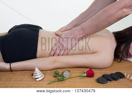 Doctor Massaging The Back Of His Patient While Using The Back