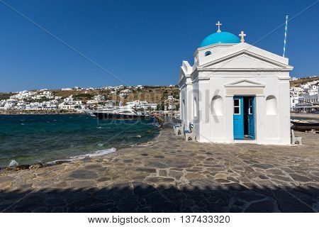 Small orthodox church on the port of town of Mykonos, Cyclades, Greece