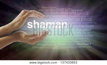 Shaman word cloud and healing hands - female cupped hands with the word SHAMAN between surrounded by word cloud on a graduated dark edged pink and green soft lit background