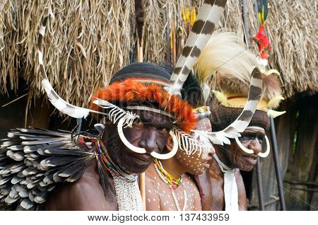 PAPUA PROVINCE INDONESIA -DEC 28: Unidentified people of a Papuan tribe in traditional clothes and coloring in New Guinea Island Indonesia on December 28 2010