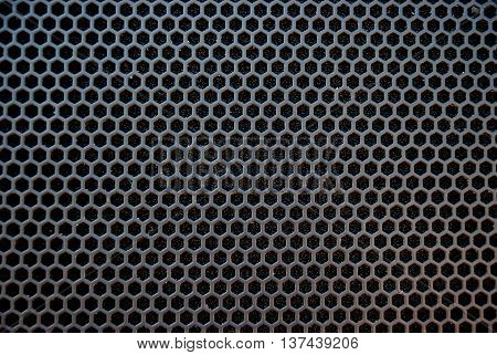 Black speaker grid texture. Industrial background. grill.