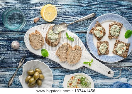 Bread with tzatziki on the blue wooden table with accessorize top view