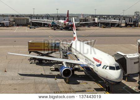 LONDON UK - APR 20 2016: British Airways airplanes at the terminal of London Heathrow international airport. Hillingdon England United Kingdom.