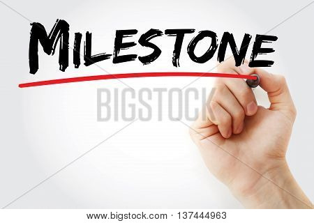 Hand Writing Milestone With Marker