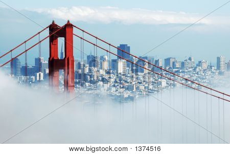 The famous San Francisco landmark Golden Gate Bridge shot from the Marin Headlands. San Francisco skyline in the background. poster