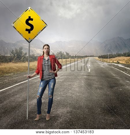 Pretty girl with roadsign . Mixed media